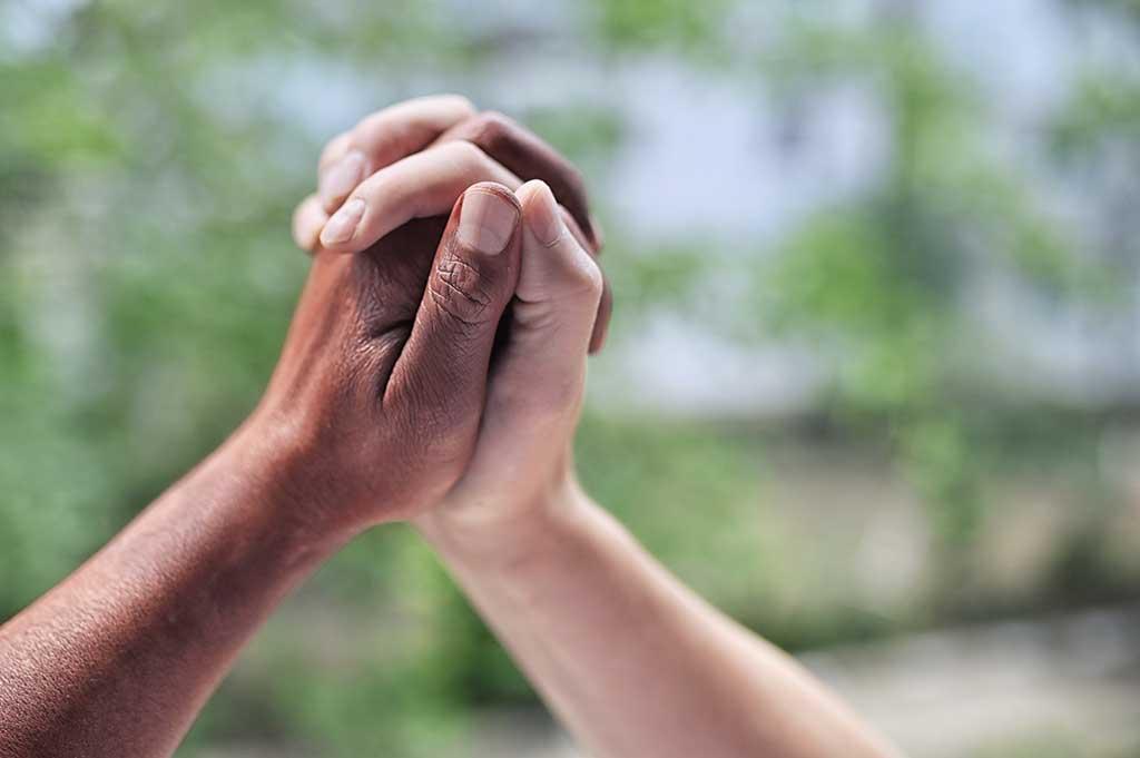 Japanese girl and black guy holding hands